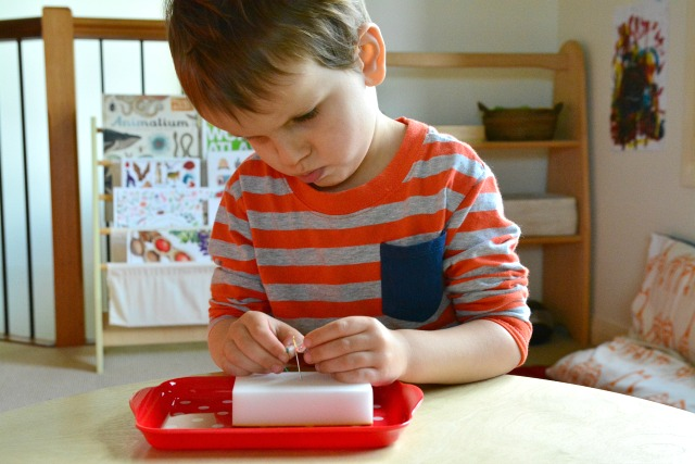 Otis threading a needle. Montessori Sewing Idea at How we Montessori