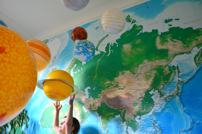 Otis with inflatable solar system at How we Montessori