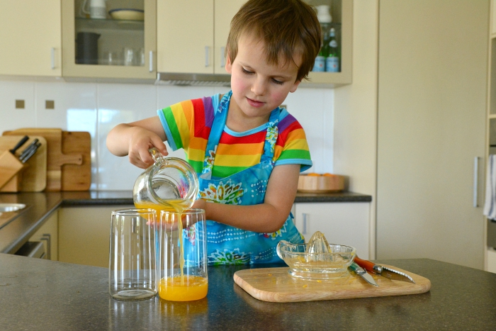 Otis pouring orange juice September 2015