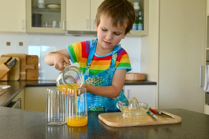 Otis pouring orange juice September 2015