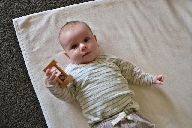 Otis with rattle at How we Montessori