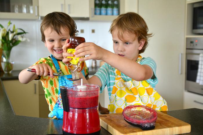 Caspar and Otis in kitchen making roll ups
