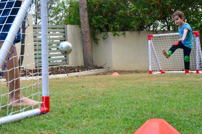 Otis and Caspar practising soccer at How we Montessori