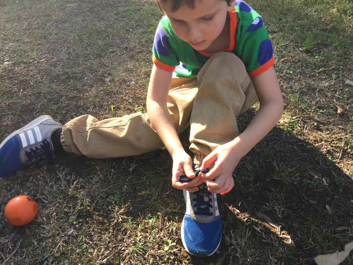 Otis tying his shoes independently