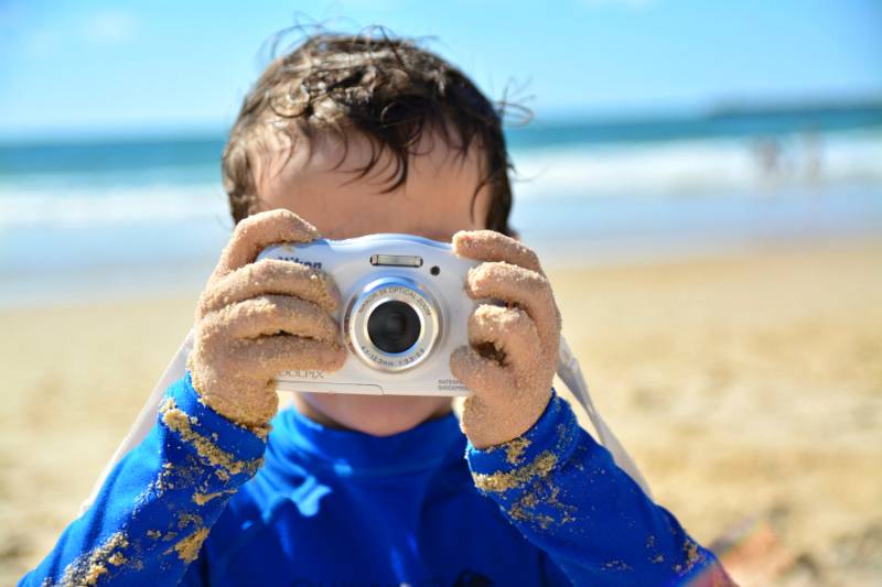 Otis taking photographs at the beach, kids camera review at How we Montessori
