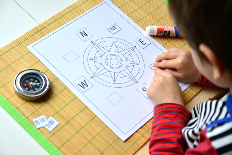 Otis with compass work, Montessori compass activity