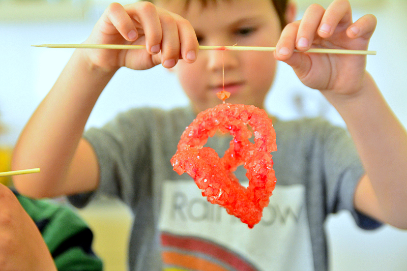 Otis with red borax crystal at How we Montessori #2