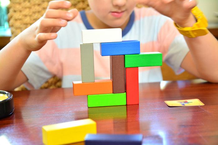 Caspar playing Make 'n' Break at How we Montessori