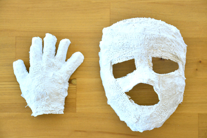 Boy's mask and hand at HWM