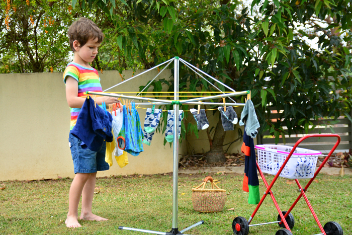 Otis hanging up the washing, child clothes hanger at How we Montessori
