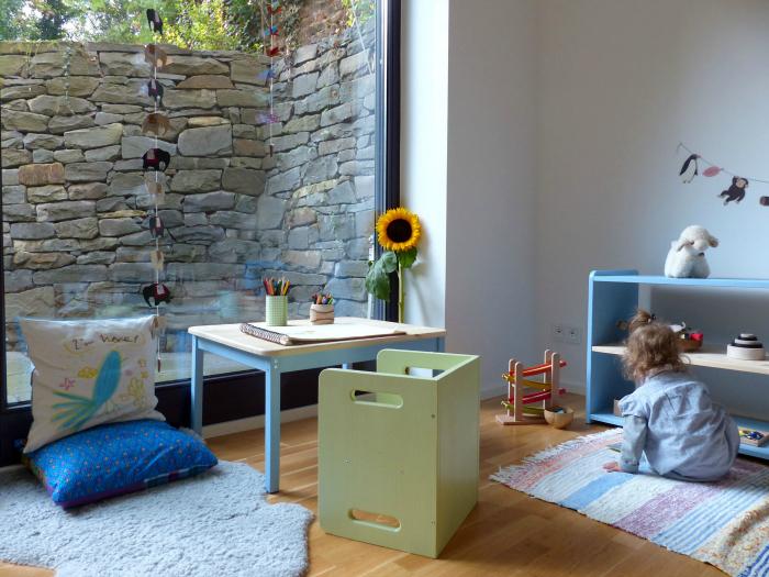 Montessori Home Child's Work area near low shelves