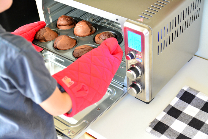 Otis baking chocolate muffins at How we Montessori