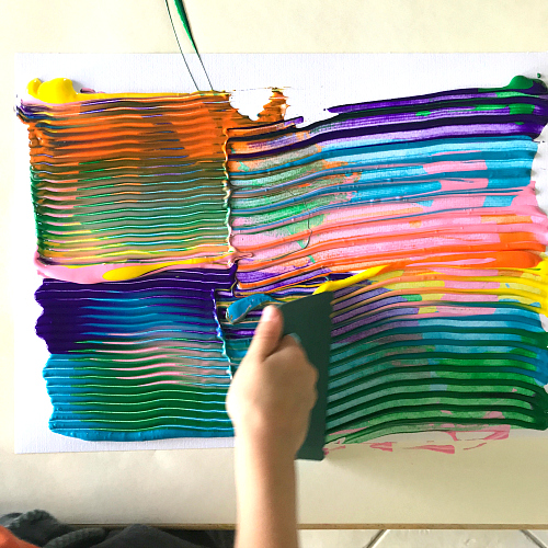 Otis using paint scraper at How we Montessori