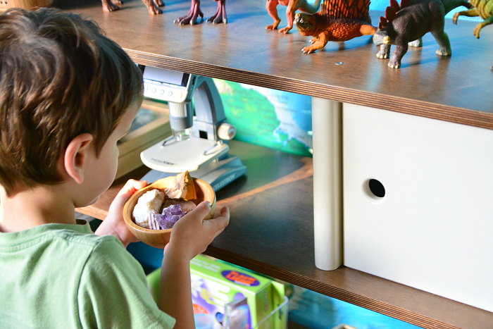 Otis looking at rocks and minerals at How we Montessori