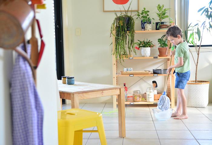 Otis washing paint off floor at How we Montessori