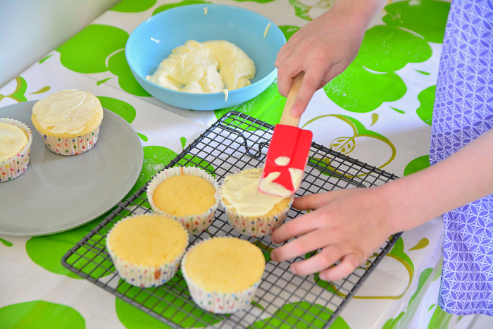 Otis frosting cupcakes at How we Montessori  making cupcakes  Montessori practical life