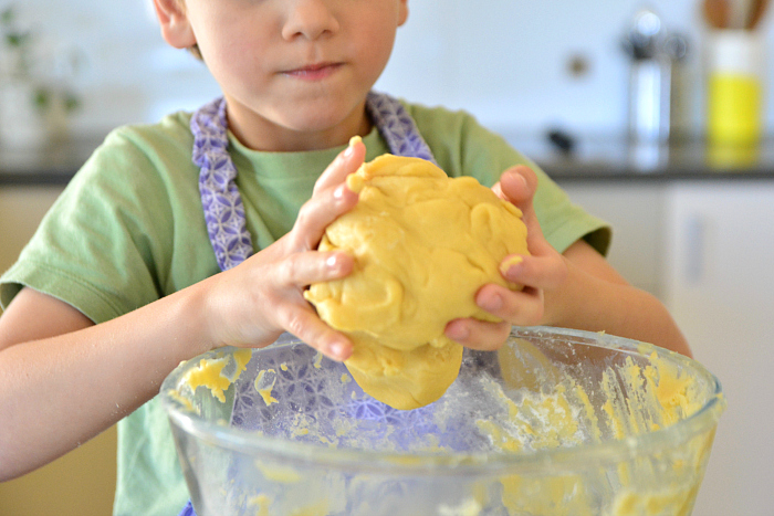 Otis with biscuit dough at How we Montessori