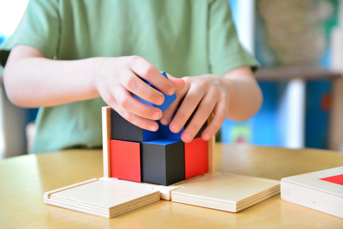 Montessori Shop Binomial Cube #7 (child completing the cube blindfolded  using sense of touch only)