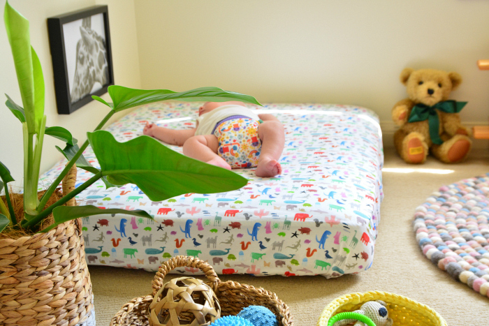 Otto on his Montessori floor bed at five weeks (1 month) at How we Montessori