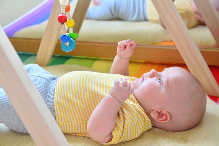 Montessori Rattle on playgym at 9 weeks