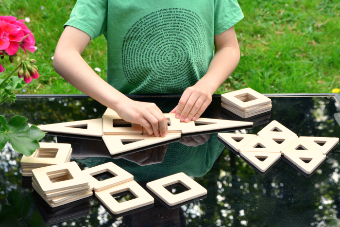 Otis with Earth Tiles at How we Montessori  making habitats  geometric shapes and awareness of spatial relationships