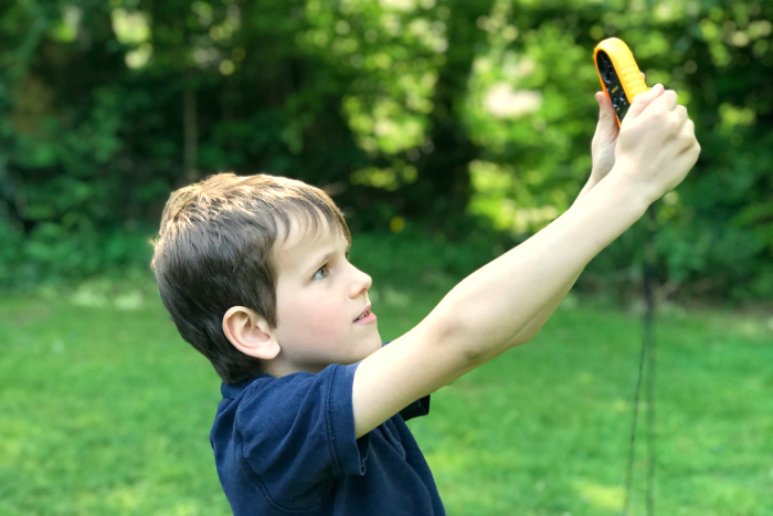 Otis checking wind speed at How we Montessori