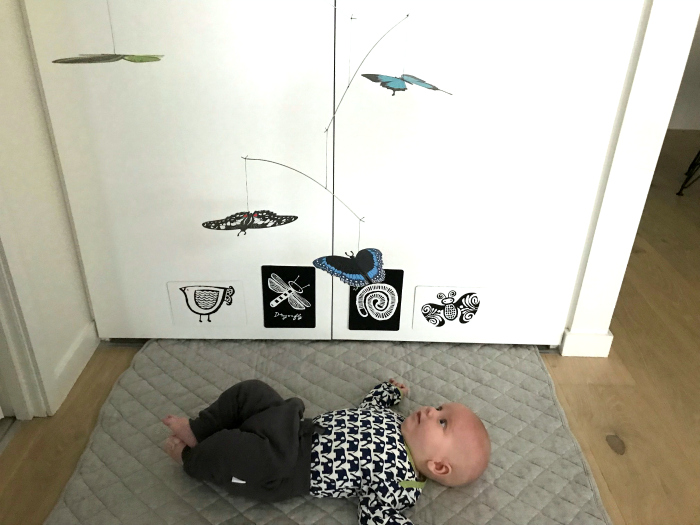 Otto using butterfly mobile at three months  in temporary accommodation