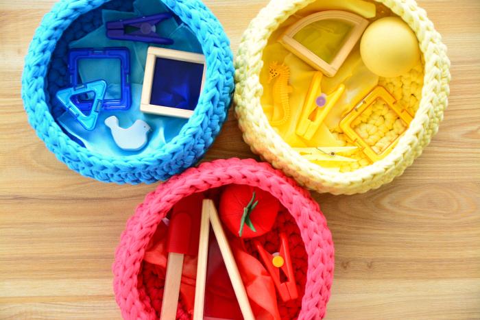 Coloured treasure baskets