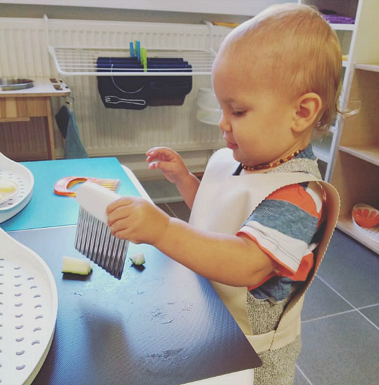 Pavel chopping with wavy knife at How we Montessori