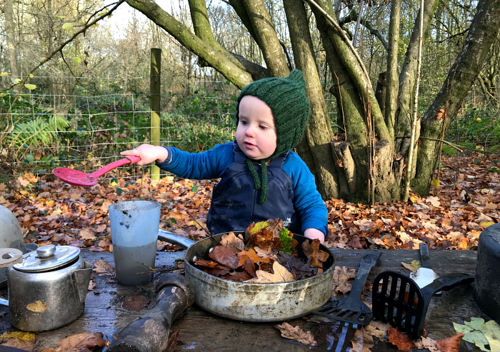 Forest School at How we Montessori  mud  kitchen Otto at 14 months