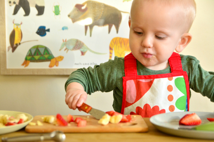 Montessori toddler making snack at 15 months at How we Montessori