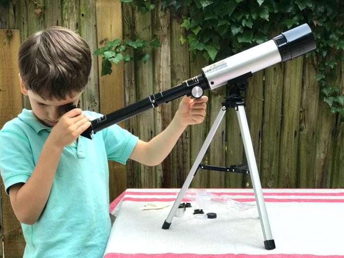 Otis using telescope  child's first telescope at How we Montessori
