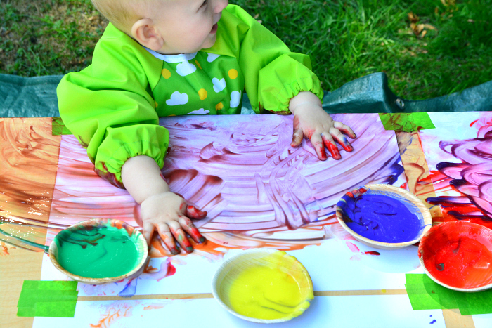 Finger painting at 11 months at How we Montessori