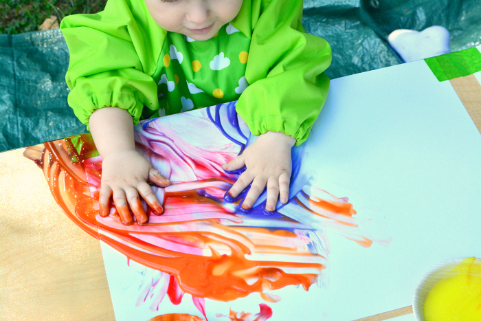 Otto finger painting at How we Montessori at 11 months