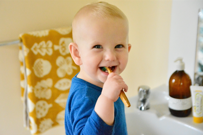 Otto brushing his teeth at How we Montessori 16 months