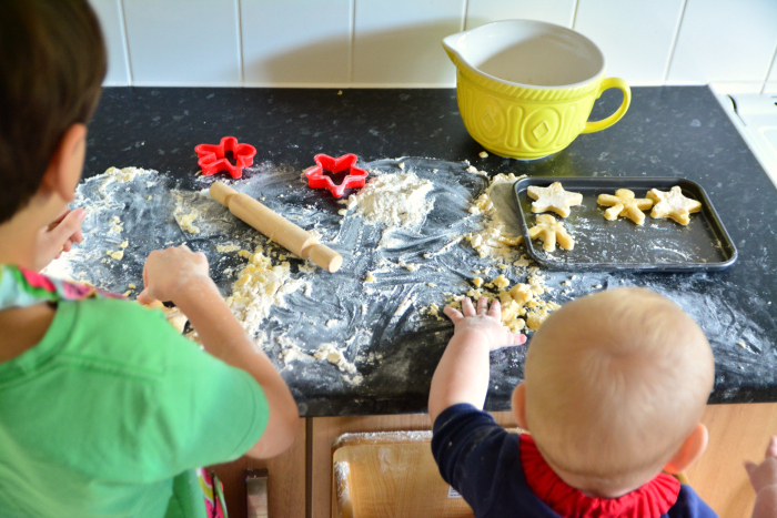 Role modelling  Otis showing Otto how to use at cookie cutter at How we Montessori at 11 months