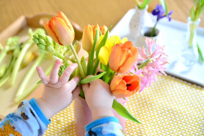 Him flower arranging toddler 16 months