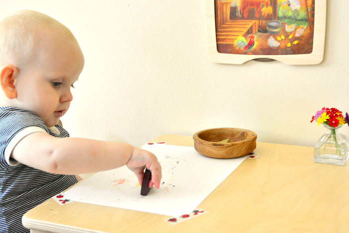 Otto with crayons at 12 months at How we Montessori