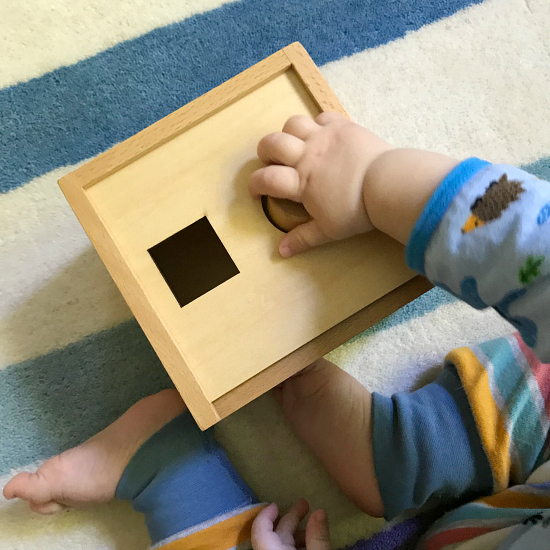 12months  Otto using Montessori shape sorter