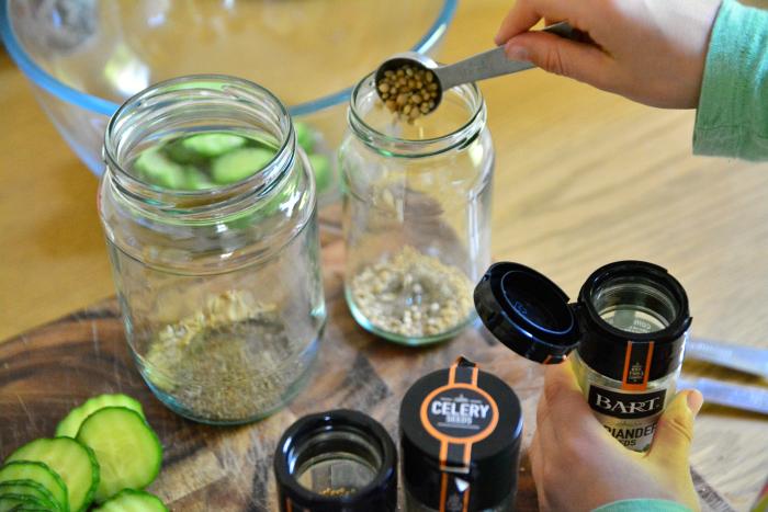 Otis choosing herbs for pickling at How we Montessori