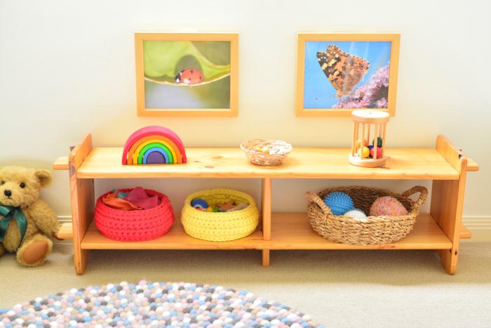 Otto  Montessori Shelves at Six Weeks at How we Montessori