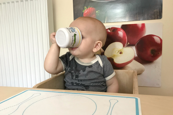 Otto drinking cup with one hand at How we Montessori  at 10 months