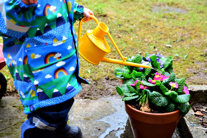 Otto watering garden at How we Montessori in winter