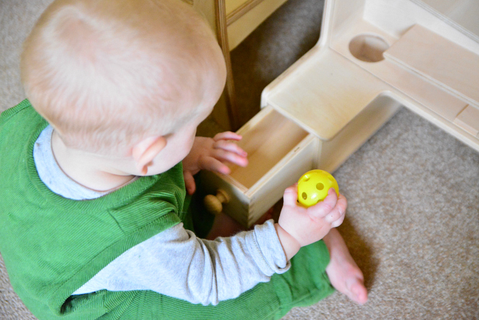 Object permanence box at 11 months at How we Montessori