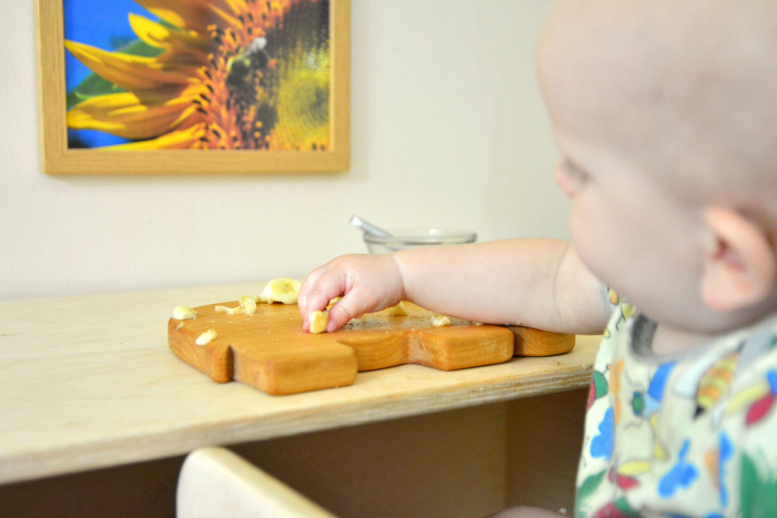 Otto with pincer grip at How we Montessori 11 months