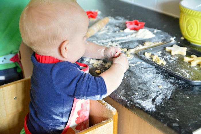 Otto baking cookies at How we Montessori 11 months FunPod