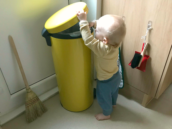 Otto putting rubbish in bin at HWM 14 months