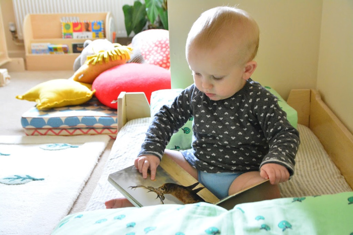 Otto reading in bed at How we Montessori 17 months 2019