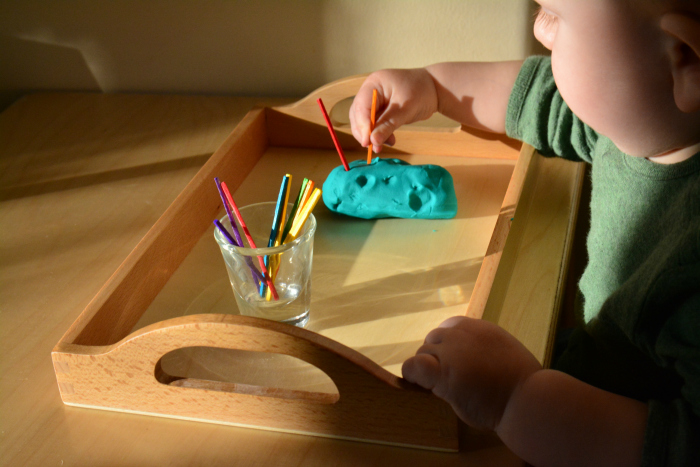 Otto threading straws at How we Montessori  montessori baby activity