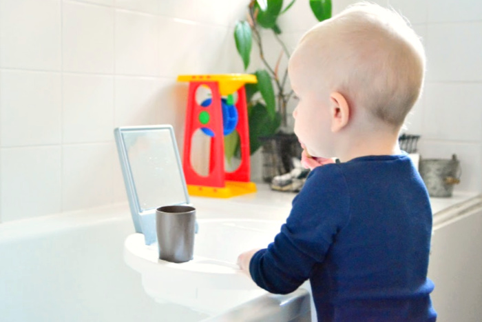 Otto with kiddywash bath basin at How we Montessori montessori toddler bathroom  how we montessori